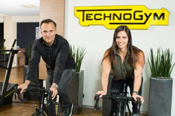 Gottfried Wurpes und Anna Veith auf Technogym MyCycling